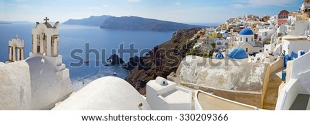Santorini - The panorama of Oia and the Therasia island in the background. - stock photo