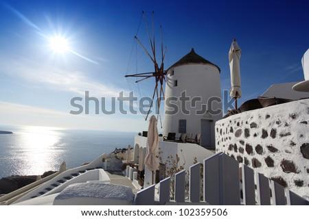Santorini with windmill in Oia village, Greece - stock photo