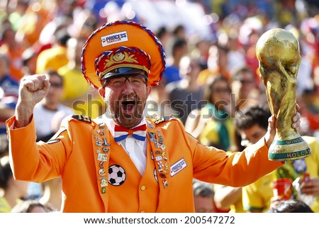 SAO PAOLO, BRAZIL - JUNE 23, 2014: A fan celebrates during the World Cup Group B game between the Netherlands and Chile at the Arena Corinthians. NO USE IN BRAZIL. - stock photo