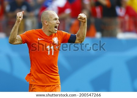 SAO PAOLO, BRAZIL - JUNE 23, 2014: Arjen Robben of the Netherlands celebrates during the World Cup Group B game between the Netherlands and Chile at the Arena Corinthians. NO USE IN BRAZIL. - stock photo