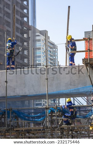 SAO PAULO, BRAZIL, APRIL 25, 2013: Workers in the construction of the elevated metro track, on Roberto Marinho Avenue, in Sao Paulo. Brazil