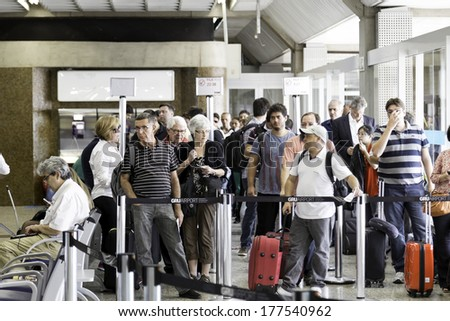 SAO PAULO, BRAZIL - CIRCA JAN 14: Passengers wait for check-in in Guarulhos Airport on in Sao Paulo, Brazil. Guarulhos is the main airport serving Sao Paulo, Brazil. - stock photo