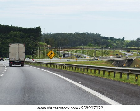SAO PAULO, BRAZIL- January, 6th 2017: Cars and trucks on a road that connects Sao Paulo to South Coast, next to the cities and beaches of  Ubatuba and Paraty