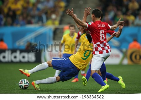 SAO PAULO, BRAZIL - June 12, 2014: Fred of Brazil & Lovren of Croatian compete for the ball during the World Cup Group A opening game between Brazil & Croatia at Corinthians Arena. No Use in Brazil