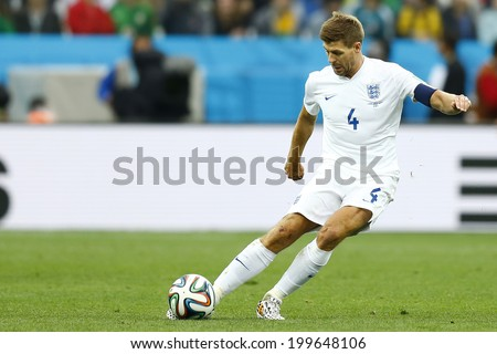 SAO PAULO, BRAZIL - June 19, 2014: Jose Gimenez of Uruguay and Steven Gerrard of England compete for the ball during the game between Uruguay and England at Arena Corinthians. No Use in Brazil. - stock photo