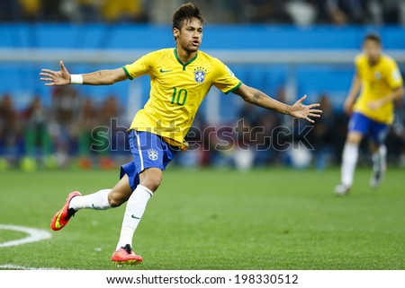 SAO PAULO, BRAZIL - June 12, 2014:Neymar (#10) of Brazil celebrates during the World Cup Group A opening game between Brazil and Croatia at Corinthians Arena. No Use in Brazil. - stock photo