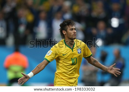 SAO PAULO, BRAZIL - June 12, 2014: Neymar of Brazil celebrates during the World Cup Group A opening game between Brazil and Croatia at Corinthians Arena. No Use in Brazil.