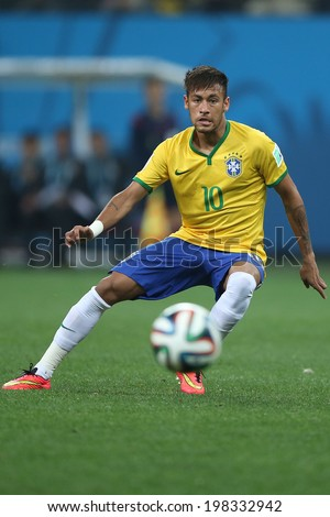 SAO PAULO, BRAZIL - June 12, 2014:Neymar of Brazil in action during the World Cup Group A opening game between Brazil and Croatia at Corinthians Arena. No Use in Brazil. - stock photo