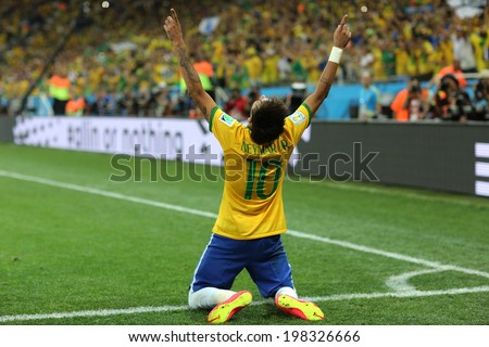 SAO PAULO, BRAZIL - June 12, 2014: Neymar (r) of Brazil celebrates during the World Cup Group A opening game between Brazil and Croatia at Corinthians Arena. No Use in Brazil. - stock photo
