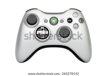 SAO PAULO, BRAZIL - MAR 13, 2014: The wireless gamepad for the Xbox 360, a home video game console produced by Microsoft, isolated on white background.