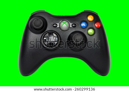 SAO PAULO, BRAZIL - MAR 13, 2014: The wireless gamepad for the Xbox 360, a home video game console produced by Microsoft, isolated on light green background. - stock photo