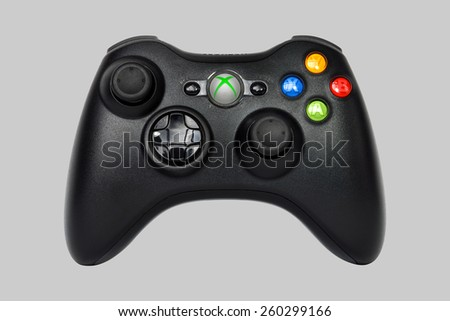 SAO PAULO, BRAZIL - MAR 13, 2014: The wireless gamepad for the Xbox 360, a home video game console produced by Microsoft, isolated on grey 25% background. - stock photo