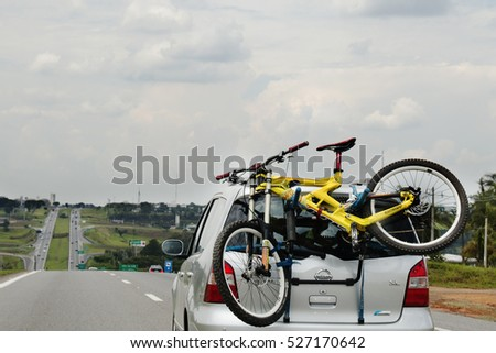 SAO PAULO, BRAZIL - NOVEMBER 26, 2016: Bicycle Loaded on the Back of a car on the road in Brazil.