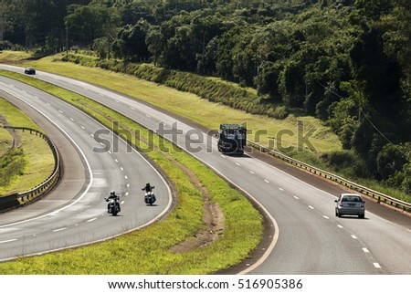 Sao Paulo, Brazil - November, 12th 2016: Vehicles a highway next to Sao Paulo with headlights on during the daylight obeying the new Brazilian transit laws.