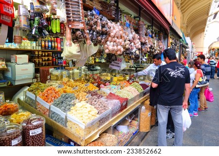 SAO PAULO, BRAZIL - OCTOBER 6, 2014: People visit Municipal Market in Sao Paulo. The market was opened in 1933 and currently sells about 350 tons of food daily in its 290 stalls.