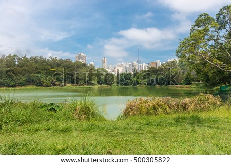 Sao Paulo, Brazil - October 15 2016: View of the city skyscrapers from the Aclimacao Park. This park was the first zoo in Sao Paulo and founded by Carlos Botelho, Brazil.