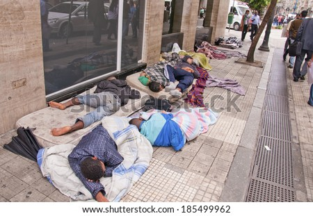 SAO PAULO-SEPTEMBER 21: people sleeping on the sidewalk in Sao Paulo. Despite being the financial center of Brazil, Sao Paulo still has many social problems. September 21, 2013 in Sao Paulo, Brazil.  - stock photo