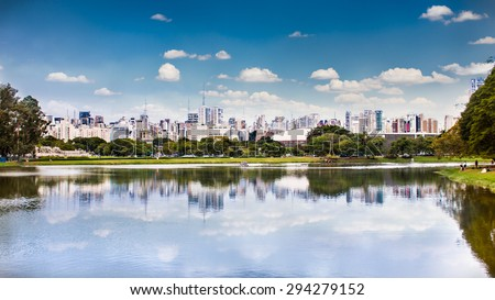 Sao Paulo skyline from Ibirapuera Park, Brazil. - stock photo