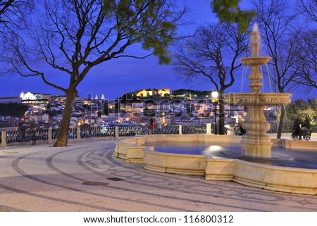 Sao Pedro de Alcantara Garden with fountain and panoramic view. Sao Jorge Castle and Graca Church in the background, Lisbon, Portugal - stock photo