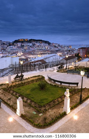 Sao Pedro de Alcantara Garden with sculptures and panoramic view. Sao Jorge Castle and Tagus River in the background, Lisbon, Portugal - stock photo