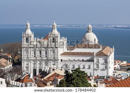 Sao Vicente de Fora Monastery, and the dome of the National Panteon (Santa Engracia church aka Panteao Nacional). Lisbon, Portugal - stock photo