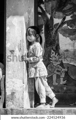 SAPA, VIETMAN - SEP 22, 2014: Unidentified Hmong girl in a primary school in Sapa, Vietnam. Hmong is a minority ethnic group of Vietnam