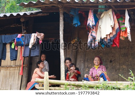 SAPA, VIETNAM - Oct 04: Unidentified Hmong family chatting at their house near Sapa, Lao Cai, Vietnam. On October 04, 2013.