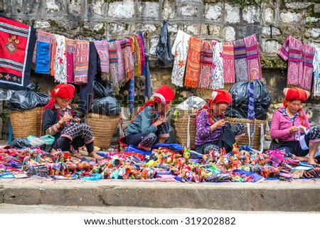 SAPA, VIETNAM - September 10,2015 : Hmong woman on the main street of Sapa on September 10,2015 in Sapa, Vietnam. Hmong people are costumes and ornate silver jewellery to sell handmade goods.