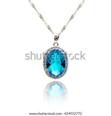Sapphire pendant isolated on white - stock photo