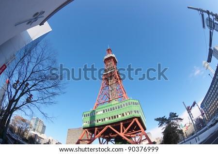 SAPPORO - DEC 8 : Sapporo TV Tower on December 8, 2011 in Hokkaido, Japan.This tower is located on the ground of Odori Park in Hokkaido, Japan. - stock photo