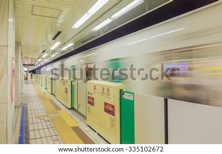 SAPPORO HOKKAIDO - NOV,4 : Subway train running that is ready departure in HOKKAIDO That is the railway platform in urban transportation. JAPAN NOV,4 2015 - stock photo