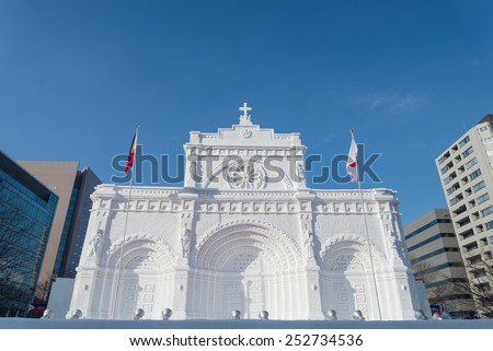 SAPPORO, JAPAN - FEB. 7 : Snow sculpture of Manira Cathedral at Sapporo Snow Festival site on February 7, 2015 in Sapporo, Hokkaido, japan. The Festival is held annually at Sapporo Odori Park.  - stock photo