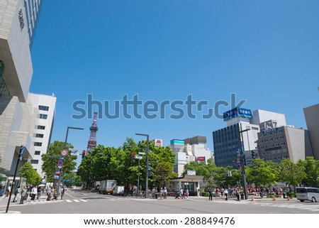 SAPPORO - JUN 9 : Sapporo Odori district and Sapporo TV Tower on June 9, 2012 in Hokkaido, Japan.The tower is located on the ground of Odori Park in Sapporo.