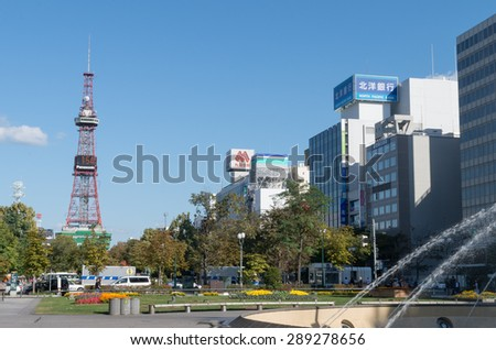 SAPPORO - OCT 9 : Sapporo TV Tower and commercial buildings at Sapporo Odori district on October 9, 2012 in Hokkaido, Japan.The tower is located on the ground of Odori Park in Sapporo. - stock photo