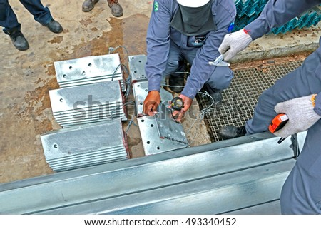 SARABURI-THAILAND-JUNE 30 : Dimension check Hot-dip galvanized steel structure by Measuring Tape on June 30, 2016 Saraburi Province, Thailand.