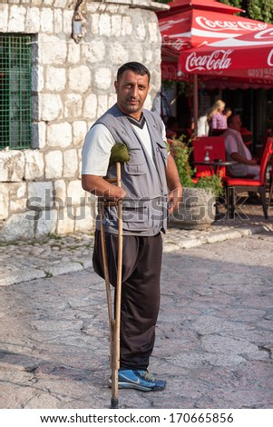 SARAJEVO, BOSNIA AND HERZEGOVINA - AUG 13: Redzep Osmani, land mine victim on August 13, 2012 in Sarajevo, B&H. Father of 10 children lost his hand and leg on land mine. - stock photo