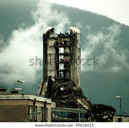SARAJEVO, BOSNIA - NOVEMBER 20: The destroyed offices of the Bosnian daily newspaper Oslobodjenia continue to stand in the besieged city of Sarajevo on Nov 20, 1993 in Sarajevo, Bosnia. - stock photo