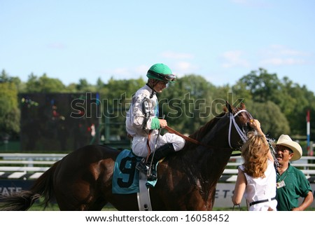SARATOGA SPRINGS - August 9: Nautical Storm with Jamie Theriot aboard after the Eight Race August 9, 2008 in Saratoga Springs, NY. - stock photo
