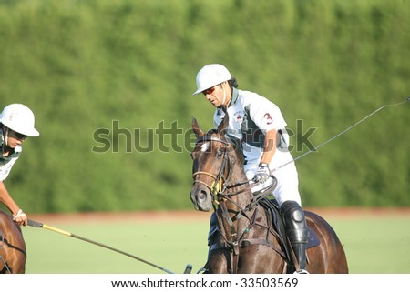 SARATOGA SPRINGS - JULY 10: M. Sosa and Louis Galvan in close action during the opening match of the season at Saratoga Polo Club July 10, 2009 in Saratoga Springs, NY. - stock photo