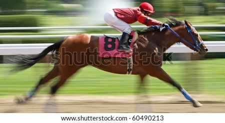 "SARATOGA SPRINGS, NY - AUG 27: Jockey James Wilsey and ""Ginowillietwoshoes"" compete in a maiden race at Saratoga Race Course on Aug 27, 2010 in Saratoga Springs, NY. - stock photo"