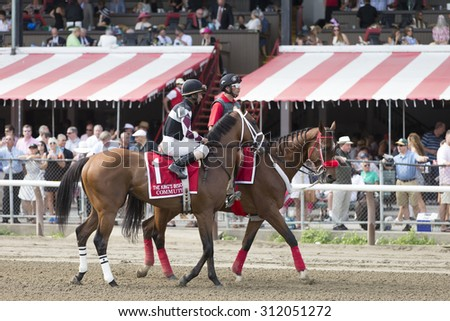SARATOGA SPRINGS, NY - August 29, 2015: Commute in the Post Parade for the King's Bishop Stakes on Travers Day at Historic Saratoga Race Course on August 29, 2015 Saratoga Springs, New York - stock photo