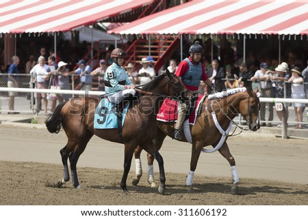 SARATOGA SPRINGS, NY - August 29, 2015: #9 Eternal Bird with I Ortiz, Jr. in  post parade for 4th race on Travers Day at Historic Saratoga Race Course on August 29, 2015 Saratoga Springs, New York - stock photo