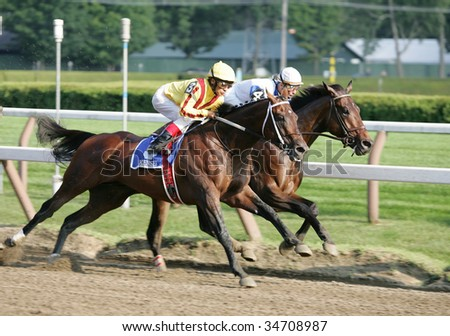 "SARATOGA SPRINGS, NY- AUGUST 1: Jockey Edgar Prado (L) on Horse ""Kensei"" battles ""Warrior's Reward"" rode by Calvin Borel to win the Jim Dandy at Saratoga Race Track August 1, 2009 in Saratoga Springs, NY - stock photo"