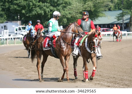 SARATOGA SPRINGS, NY- AUGUST 1:  John Velazquez (L) aboard Vivi's Book in the post parade for the Lake Luzerne Stakes at Saratoga Race Track August 1, 2009 in Saratoga Springs, NY.