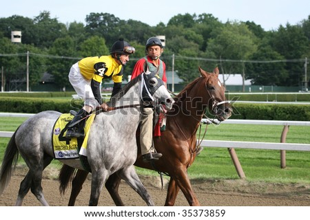 "SARATOGA SPRINGS, NY- AUGUST 8: ""Macho Again"" with Robby Albarado aboard in the Post Parade for The Whitney Stakes at Saratoga Race Track, August 8, 2009 in Saratoga Springs, NY."