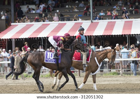 SARATOGA SPRINGS, NY - August 29, 2015: March in the Post Parade for the King's Bishop Stakes on Travers Day at Historic Saratoga Race Course on August 29, 2015 Saratoga Springs, New York - stock photo