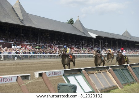 SARATOGA SPRINGS, NY - August 29, 2015: Unbridled Forever with J R. Velazquez up wins the Ballerina Stakes on Travers Day at Historic Saratoga Race Course on August 29, 2015 Saratoga Springs, New York - stock photo
