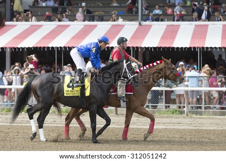 SARATOGA SPRINGS, NY - August 29, 2015: Watershed in the Post Parade for the King's Bishop Stakes on Travers Day at Historic Saratoga Race Course on August 29, 2015 Saratoga Springs, New York - stock photo