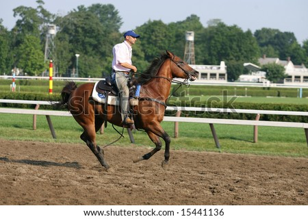 Saratoga Springs, NY, July 26th 2008 - Trainer Tom Albertraini rides his track horse as he watches his horse in morning workouts on Saratoga's Main Track