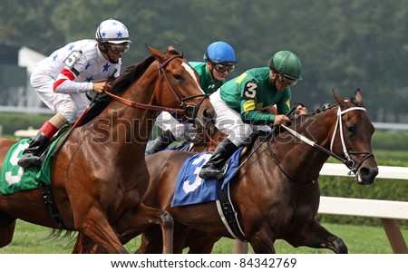 "SARATOGA SPRINGS, NY - SEPT 4: ""Dust and Diamonds"" (Javier Castellano up) edges out ""Fantasy of Flight"" to win an allowance race at Saratoga Race Course on Sept 4, 2011 in Saratoga Springs, NY. - stock photo"